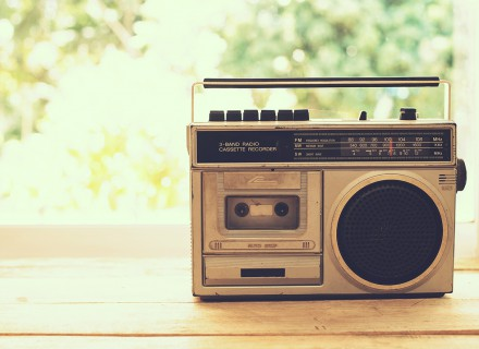 vintage radio on table nature background, instagram filter